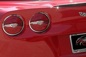 American Car Craft® - Executive Style Polished Tail Light Covers with Corvette Logo