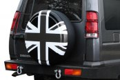 Image may not reflect your exact vehicle! Boomerang® - Rigid Series Union Jack Tire Cover