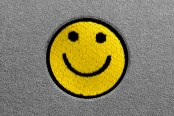 Dash Designs® - Smiley Face Embroidered Logo