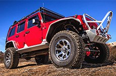DICK CEPEK® - TORQUE Gunmetal with Machined Flange on Red Jeep Wrangler