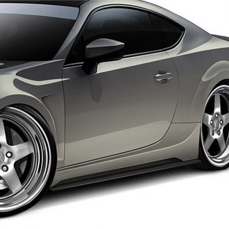 Carbon Creations® - 86-R Style Fiberglass Wide Body Side Skirts