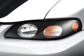 Image may not reflect your exact vehicle! GTS® - Carbon Fiber Pro-Beam™ Headlight Covers