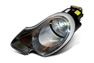 HELLA® 010054031 - Driver Side Replacement Headlight