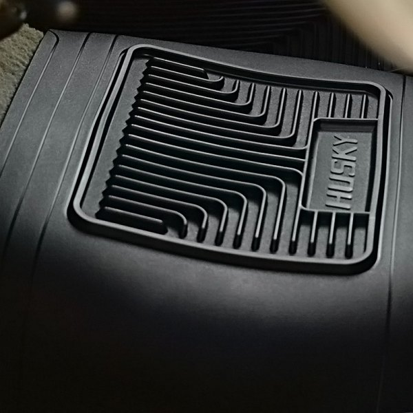 Image may not reflect your exact vehicle! Husky Liners® - Heavy Duty Center Hump Area Black Floor Mat