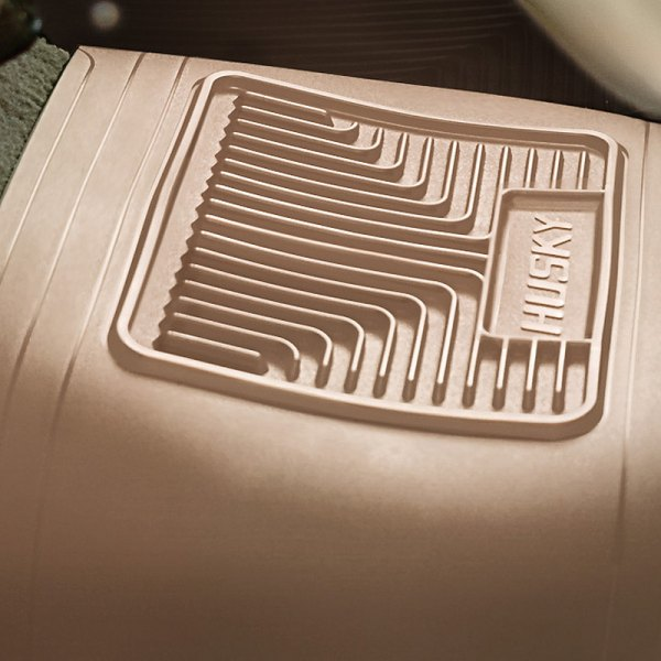 Image may not reflect your exact vehicle! Husky Liners® - Heavy Duty Center Hump Area Tan Floor Mat