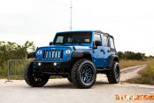 Blue Jeep Wrangler JK Unlimited with soft top