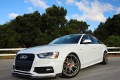 White Audi A4 Stands Out with Custom Front Lip Spoiler