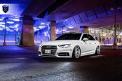 Stylish and Sinister: Glossy White Audi A4 Rolling on Rohana Wheels