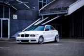 Cute White BMW 1-Series on Chrome Buttoms