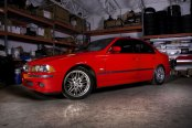 Cardinal Comfort: Customized Red BMW 5-Series