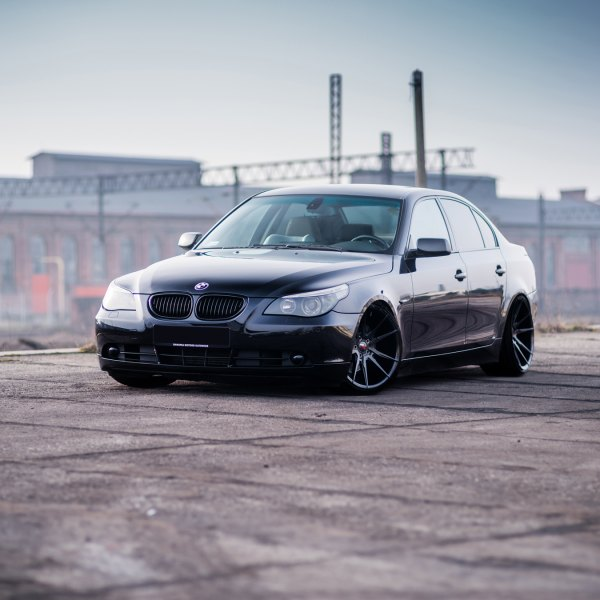 Black BMW 5 Series With Aftermarket Front Bumper