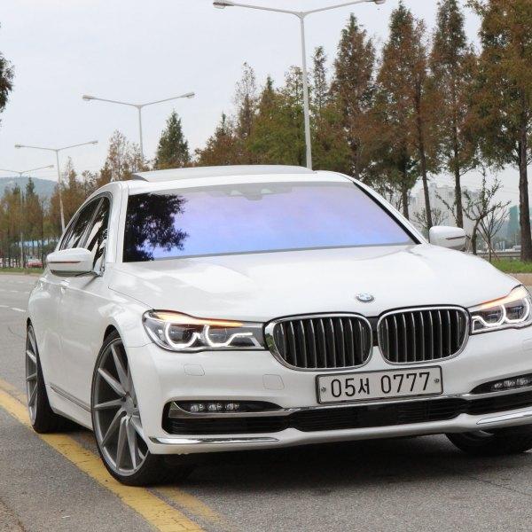 White BMW 7 Series With Custom LED Halo Headlights
