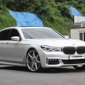 White BMW 7 Series With Aftermarket Headlights