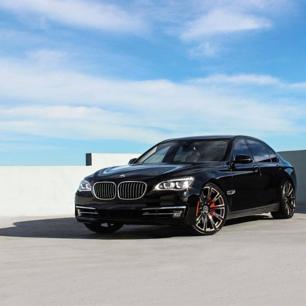 Black BMW 7 Series With Aftermarket Headlights