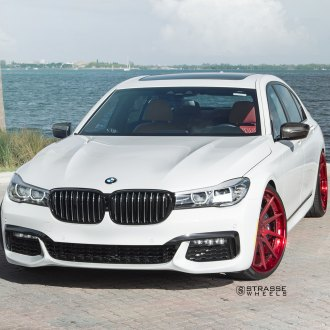 White BMW 7 Series With Aftermarket Front Bumper
