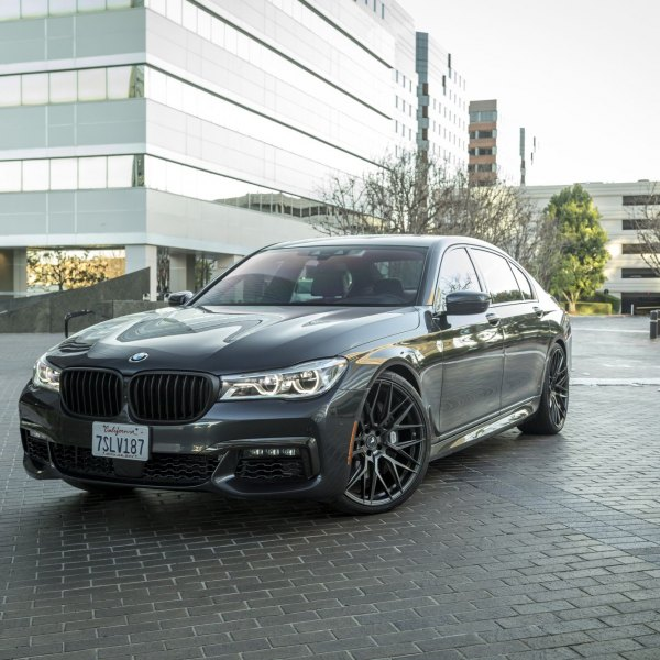 Black BMW 7 Series With Aftermarket Halo Headlights