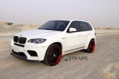White BMW X5 on Contrasting Matte Black Strasse Wheels Featuring Red Lip