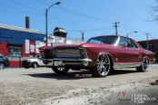 Stunning Donk Detected: Red Buick Riviera with Chrome Elements