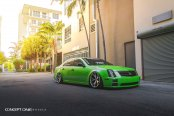 Green with Mean Cadillac STS Lowered and Dressed Up with Custom Parts