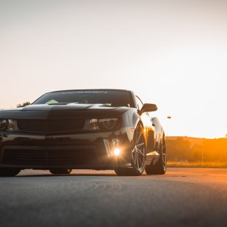Custom Accessories Emphasizing the Muscular Look of Black Chevy Camaro