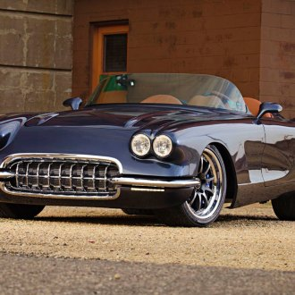 Charming Black Convertible Chevy Corvette Wearing Chrome Grille