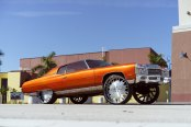 Hot Orange Hi-riser Chevy Impala