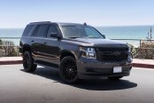 Black on Black Chevy Tahoe with Custom Projector Headlights