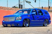 Dropped Royal Blue Chevy Tahoe on Color Matched Wheels