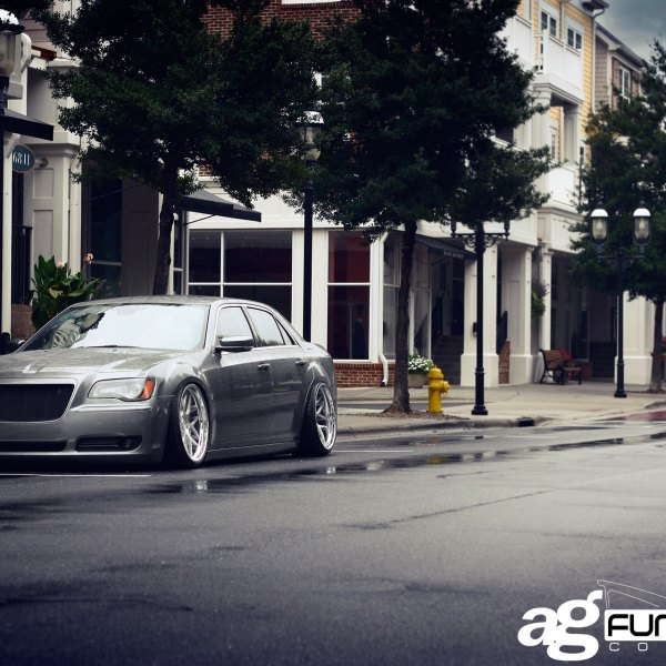 Gray Stanced Chrysler 300 with Aftermarket Headlights - Photo by Avant Garde Wheels