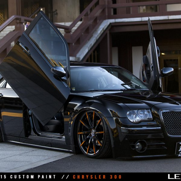 Lowered Chrysler 300 with Custom Vertical Doors - Photo by Lexani