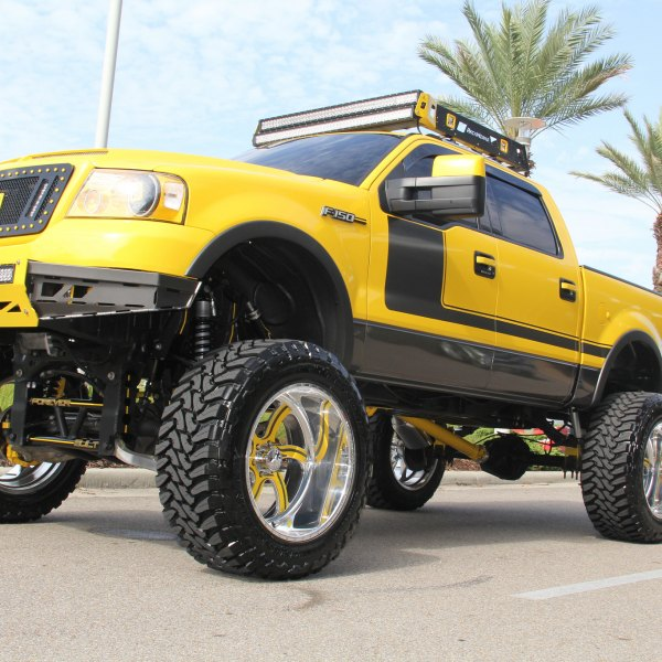 Boss 302 Style Painted F150 With a Lift and Large Tires - Photo by American Force