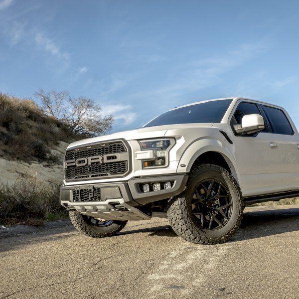 White Lifted Ford F-150 with Aftermarket Headlights  - Photo by Vorsteiner