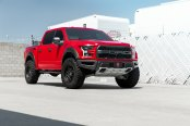 Bold Red F-150 Raptor Looking Mean on Black Rhino Wheels