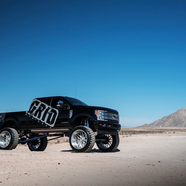 Black Lifted Ford F-250 with Custom Running Boards - Photo by Grid Off-Road