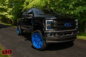 Blue Wheels and Contrasting Accents Make Black F-250 Stand Out