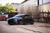 Black Ford Focus Showing Off Bronze JR Wheels