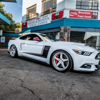 Classy 5 Spoke Rims Wrappped in Continental Tires Adorning White Ford Mustang 5.0