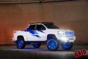 Mall Crawler White Lifted GMC Sierra Rocking Blue Grid Off-Road Rims