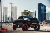 Amazing Black Lifted GMC Sierra with Red Accents and Off-Road Rims