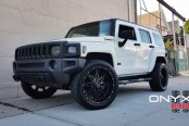 Royal White Hummer H3 Wearing Gloss Black Onyx Wheels