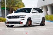 Custom Jeep Grand Cherokee with Red Accents and Vossen Wheels