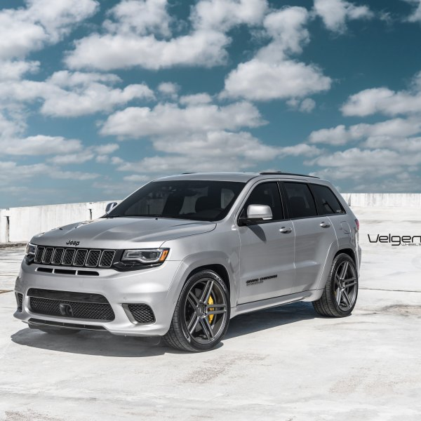 Silver Jeep Grand Cherokee with Aftermarket Headlights - Photo by Velgen