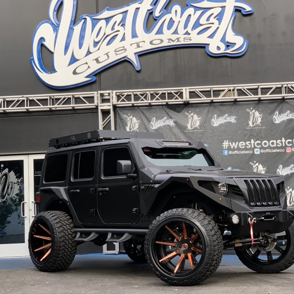 black lifted jeep wrangler with off-road front bumper - photo by forgiato