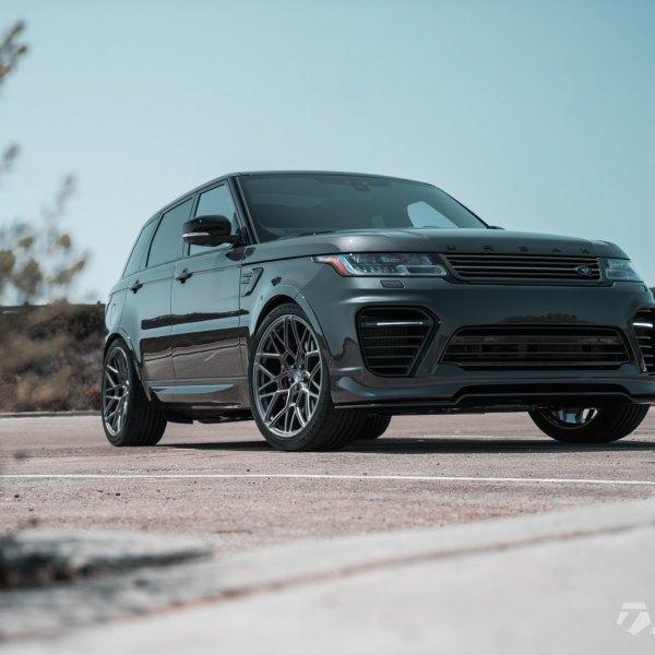 black range rover sport with aftermarket front bumper - photo by vossen