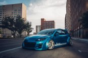 Extremely Exotic Clinched Body Kit on Blue Mazda 3
