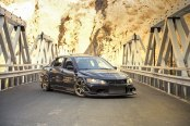 JDM Tuning Looks Well on Black Mitsubishi Evolution