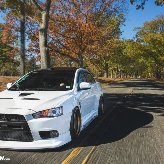 White Stanced Mitsubishi Evolution Gets a Distinctive Look with Custom Front Lip