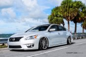 Jaw-Dropping White Pearl Debadged Nissan Altima Customized to Amaze