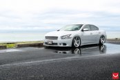 Tuning Kit on Silver Nissan Maxima Featuring Chrome Elements