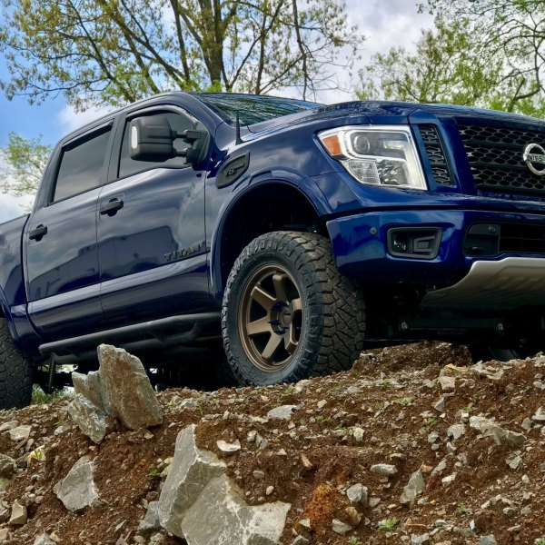 Blue Nissan Titan V8 with Blacked Out Mesh Grille - Photo by Black Rhino Wheels